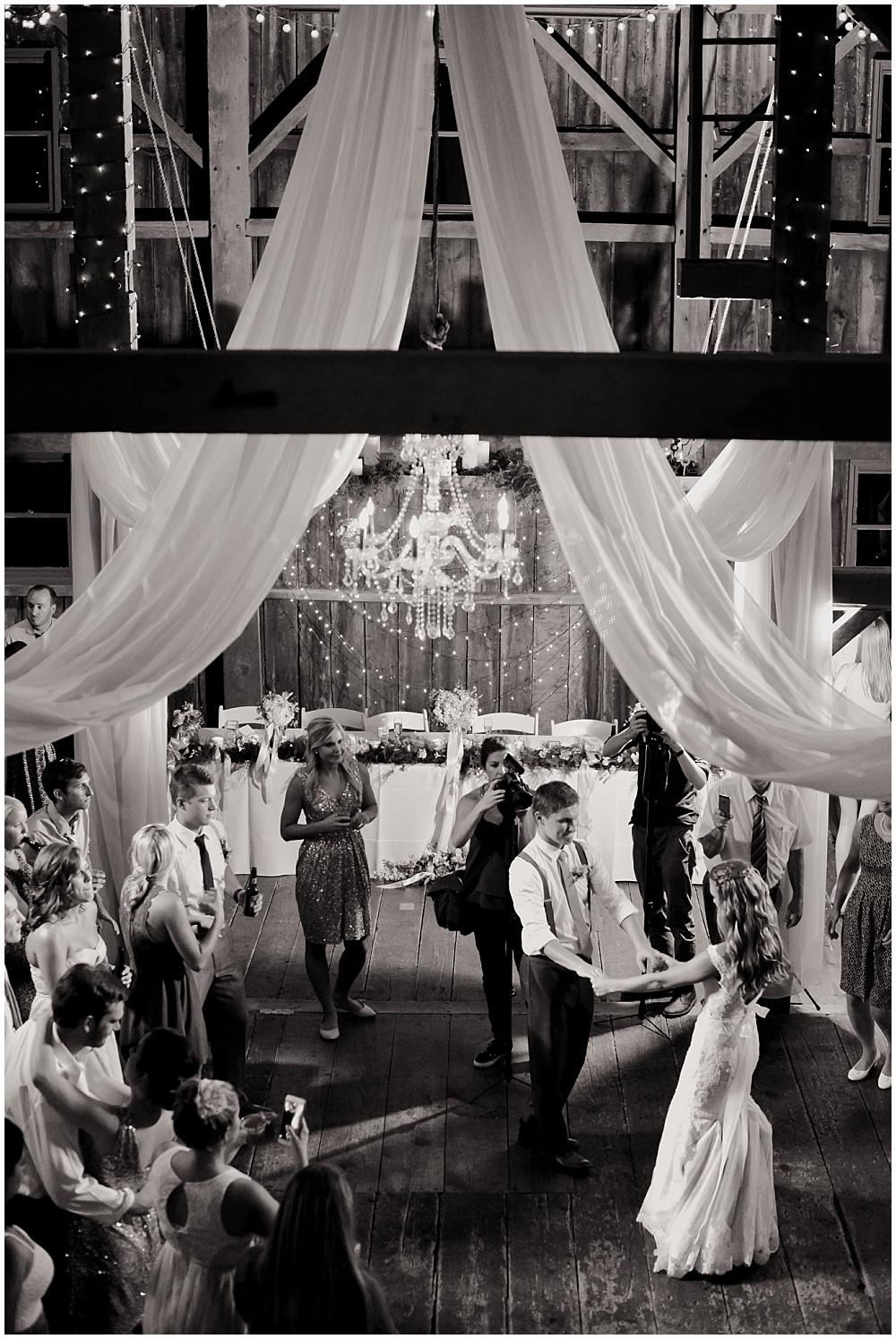 First Dance under chandelier and draped fabric | Mustard Seed Gardens Wedding by Sara Ackermann Photography & Jessica Dum Wedding Coordination