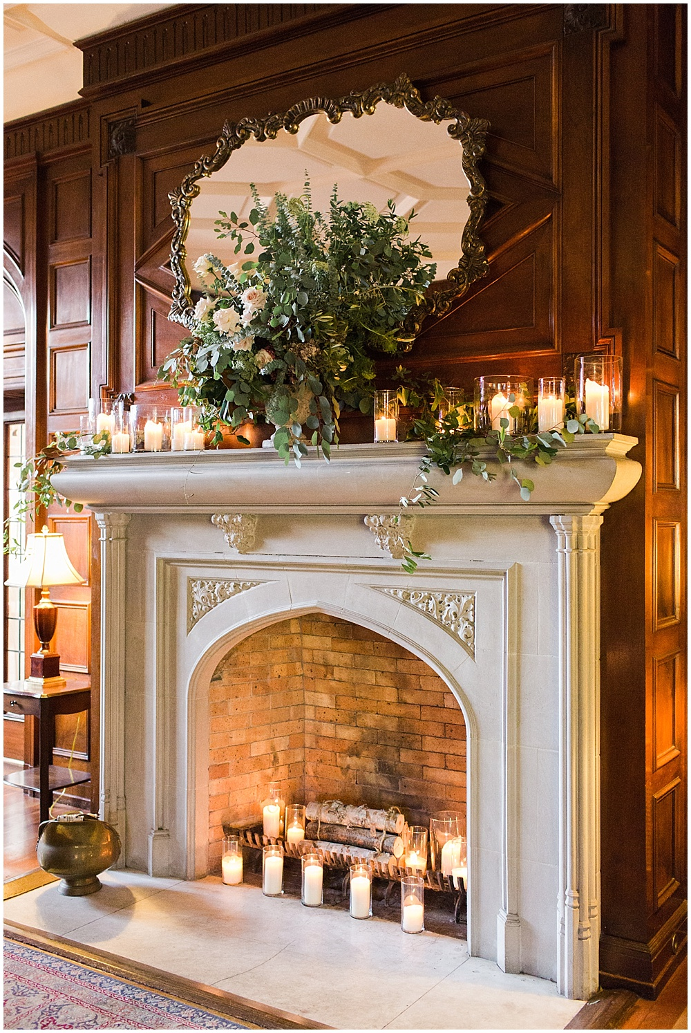 candles and florals fireplace | Navy and Gold Wedding at Laurel Hall with Ivan & Louise Photography + Jessica Dum Wedding Coordination