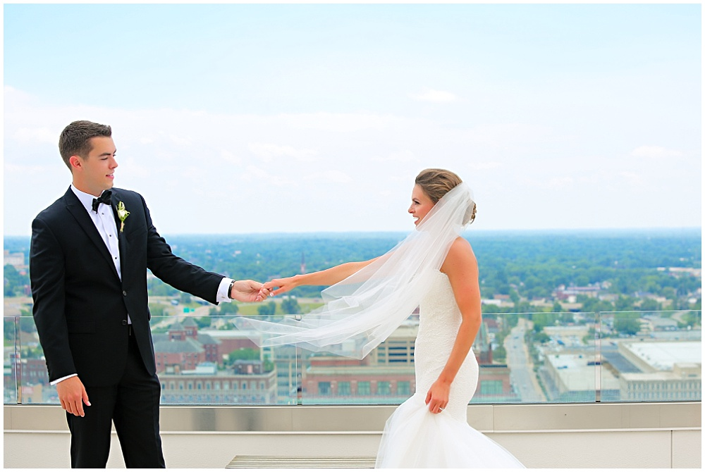 Bride and groom first look overlooking the city | elegant gold downtown wedding | Jessica Strickland Photography and Jessica Dum Wedding Coordination