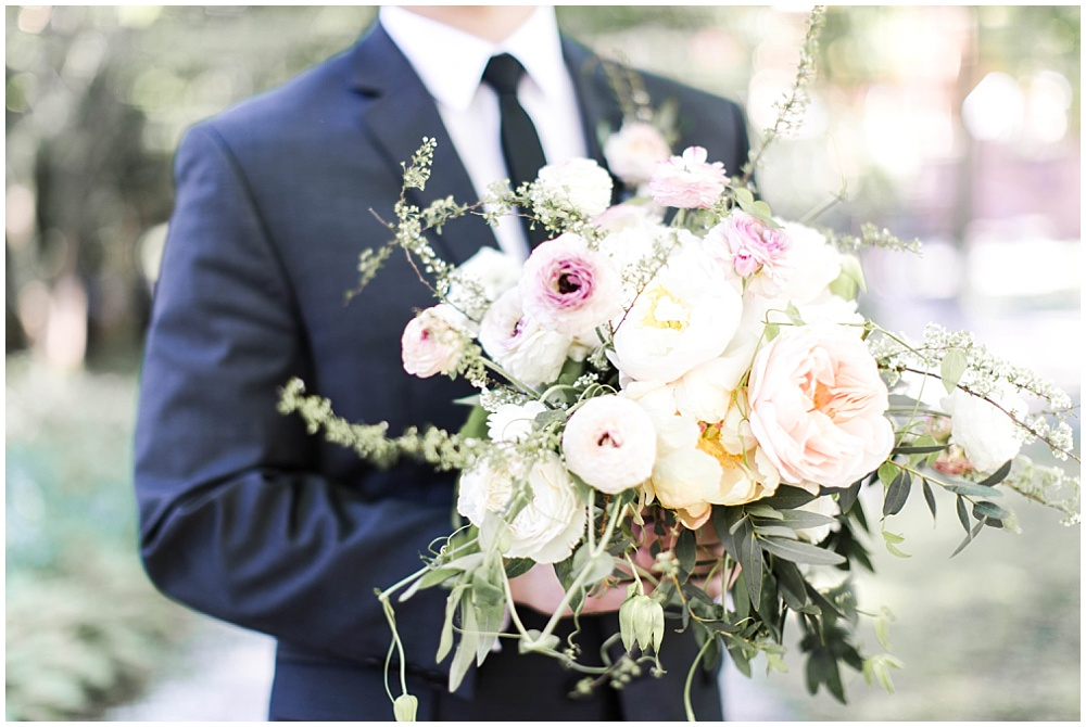 Groom holding sppring blush, peach and purple wedding bouquet, Spring floral + gold wedding | Ivan & Louise Images | Jessica Dum Wedding Coordination