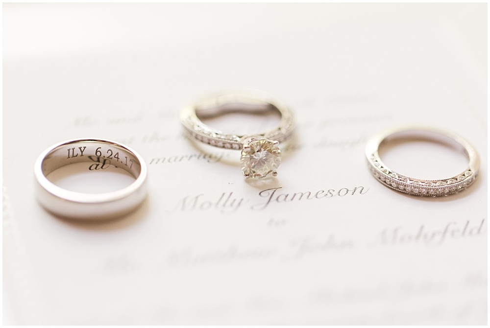 Engraved wedding ring; ring photos on top of wedding invitation | Sami Renee Photography + Jessica Dum Wedding Coordination