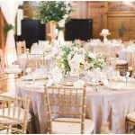 gold crush linens; ivory and gold tablescape; ivory flowers with greenery; gold chiavari chairs; Scottish Rite Cathedral Indianapolis Wedding; neutral floral and greenery wedding| Ivan & Louise Images and Jessica Dum Wedding Coordination