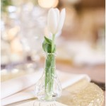 individual bud vases with white flowers for each guest; glass vanilla lace BBJ Linen chargers; ivory and gold tablescape; Scottish Rite Cathedral Indianapolis Wedding; neutral floral and greenery wedding| Ivan & Louise Images and Jessica Dum Wedding Coordination