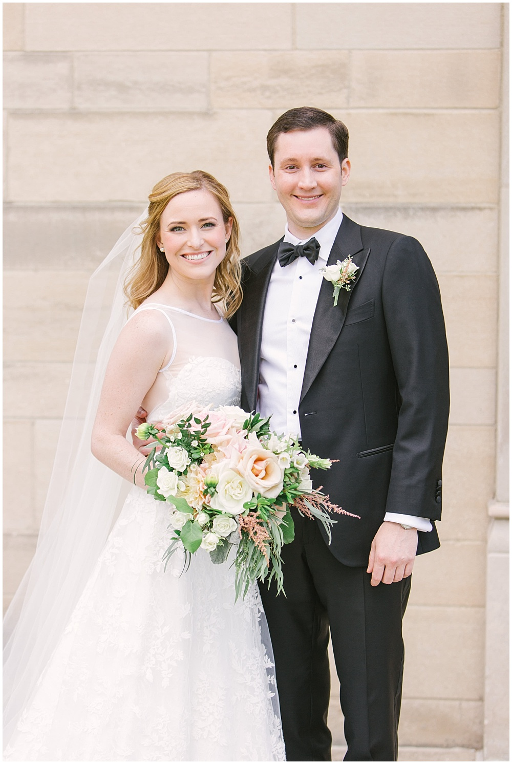 brida and groom portraits; white wedding dress; blush and white bridal bouquet with greenery; Navy + blush wedding; Scottish Rite Cathedral Indianapolis | Traci & Troy Photography and Jessica Dum Wedding Coordination