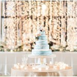 blue naked cake; white pedestal cake stand; twinkle lights; draped lighting; cake flowers; Mexican inspired gold & floral wedding; Crowne Plaza Indianapolis Downtown Union Station; neutral floral and greenery wedding|Cory + Jackie and Jessica Dum Wedding Coordination