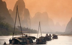 14. The Li River, where guests will take a traditional cormorant fishing excursion and sail past water buffalo and rafts to the town of Yangshuo