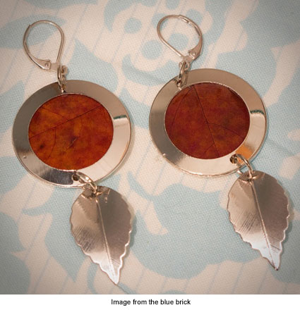 earrings made from preserved leaves framed in silver