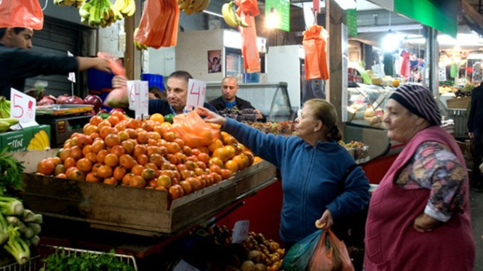 Women buying produce at the Shuk haCarmel, Tel Aviv. Steve Lubetkin Photo/Used by permission.