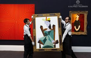 LONDON, ENGLAND - OCTOBER 10:  Frank Stella's Delaware Crossing (est $8-12m) Picasso's Femme assise sur une chaise (est. $25-35) and Modigliani's Portrait de Paulette Jourdain (Estimate Upon Request) from the collection of A. Alfred Taubman are displayed as part of the Frieze week exhibition at Sotheby's on October 10, 2015 in London, England. Opening to the public this week the exhibition features highlights from the most valuable private collection ever offered at auction, the collection of A. Alfred Taubman, which spans Antiquities, Old Masters, Impressionist, Modern and Contemporary Art.  (Photo by Tristan Fewings/Getty Images for Sotheby's)