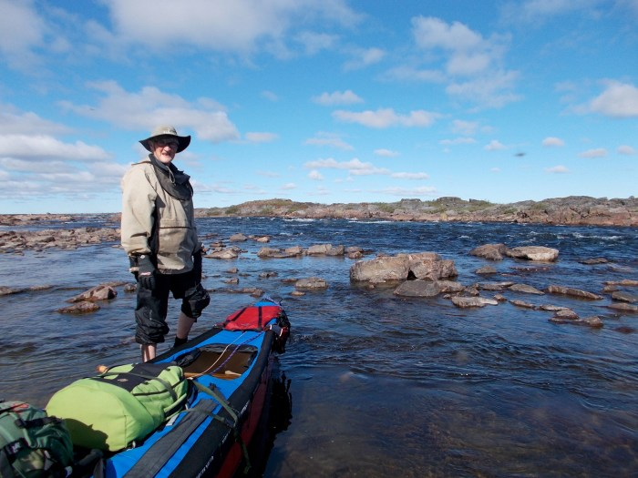 Lining and dragging the canoe in shallow water, upper Uksuriajuaq Rapids