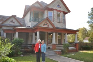 Mary Tippett stands with MaryBeth before the house her grandfather built in 1911