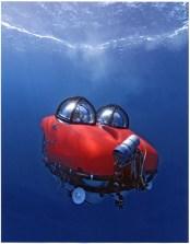 """John (left) """"driving"""" submarine with Waitt Institute's Mike Dessner."""