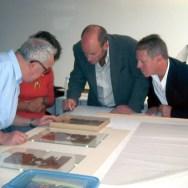 Heubusch (right) joins Professor Rudolph Kasser (left) and Waitt Institute founder Ted Waitt in examining restoration of the lost Gospel of Judas.