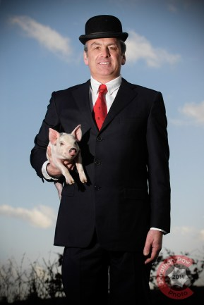 Corporate portrait with pig, this was a René Magritte inspired idea of mine