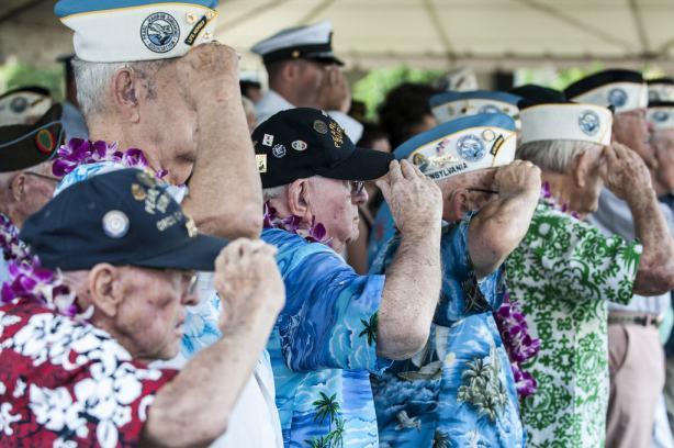 Pearl Harbor survivors salute.