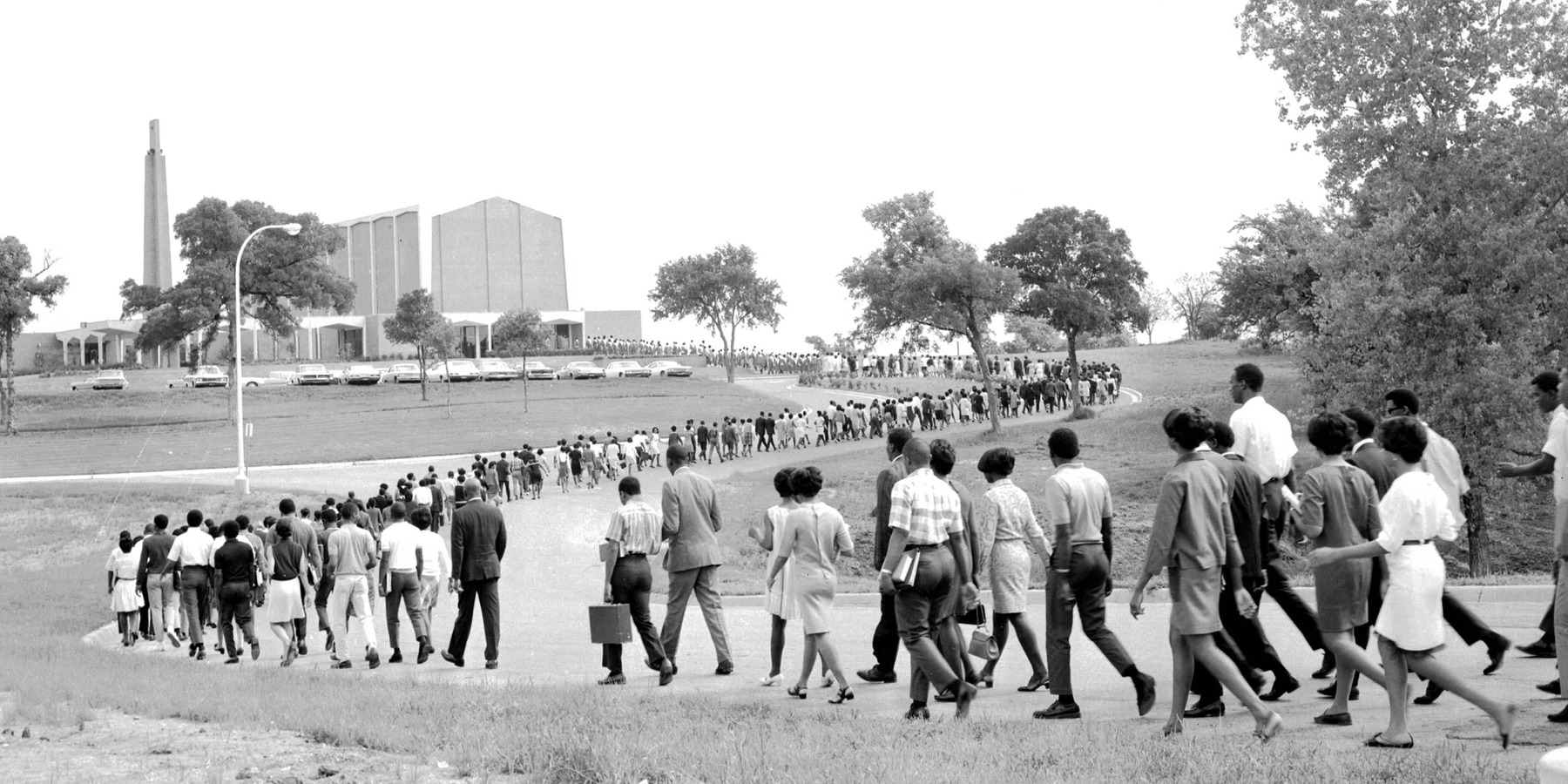 Faculty, staff and students walk toward Bishop College Chapel in Dallas for an all-night prayer vigil on April 4, 1968, after the murder of the Rev. Martin Luther King, Jr. in Memphis. In other cities, violence erupted. (Credit: Dallas Public Library)