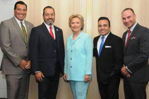 At last year's convention of the National Association of Black Journanlists and National Association of Hispanic Journalists: Alberto B. Mendoza, NAHJ executive director, left; Hugo Balta, convention co-chair and past NAHJ president, Democratic presidential candidate Hillary Clinton, NAHJ president MekahloMedina and Francisco Cortés. (Credit: NAHJ)