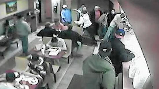 Two off-duty cops face firing a decade after off-duty beating captured on video. (Credit: Chicago Tribune)