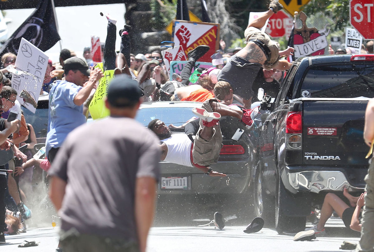 """In this widely circulated photo, a vehicle plows into a group of protesters at the """"Unite the Right"""" demonstration in Charlottesville, Va., on Saturday. (Credit: Ryan J. Kelly/Daily Progess, Charlottesville)"""