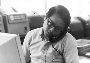 A 1980 photo shows Gordon Sakamoto at work in the UPI bureau in Honolulu . (Credit: Family)