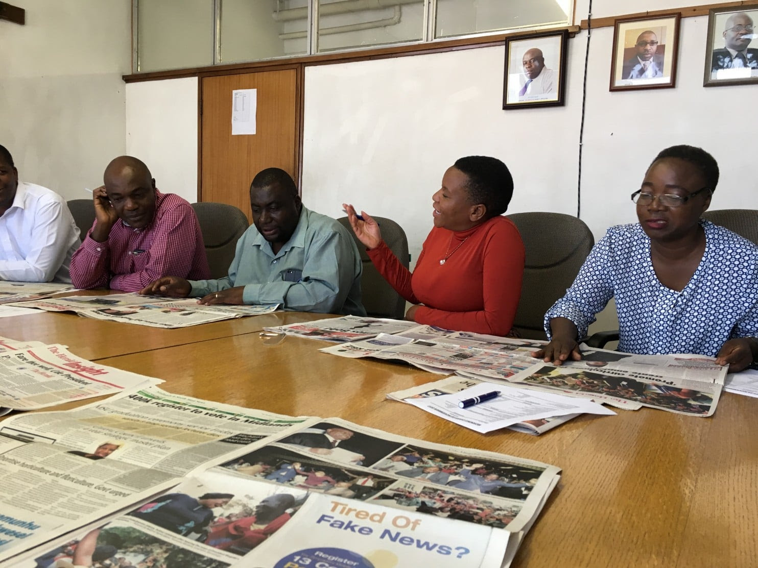 Reporters and editors plan the daily coverage of the Zimbabwe Herald. The state-owned newspaper was forced this month to cover the downfall of Robert Mugabe, whose rule it had long applauded. (Credit: Kevin Sieff/Washington Post)