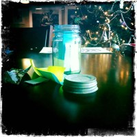 A Blue Mason Jar Full of Post-It Notes Goals for The New Year