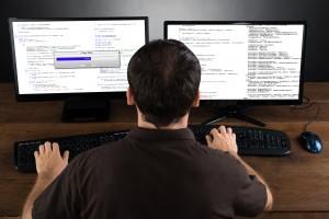 Man Programming Code On Computers