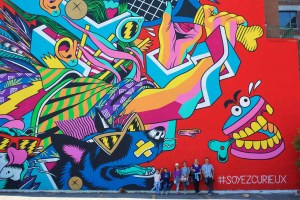 people-in-front-of-giant-wall-graffitti