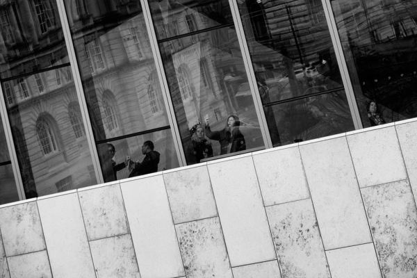 Visitors at the Museum of Liverpool photographing the Three Graces