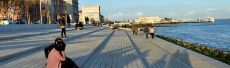 Late afternoon shadows and a view back towards Praça do Comércio in Lisbon