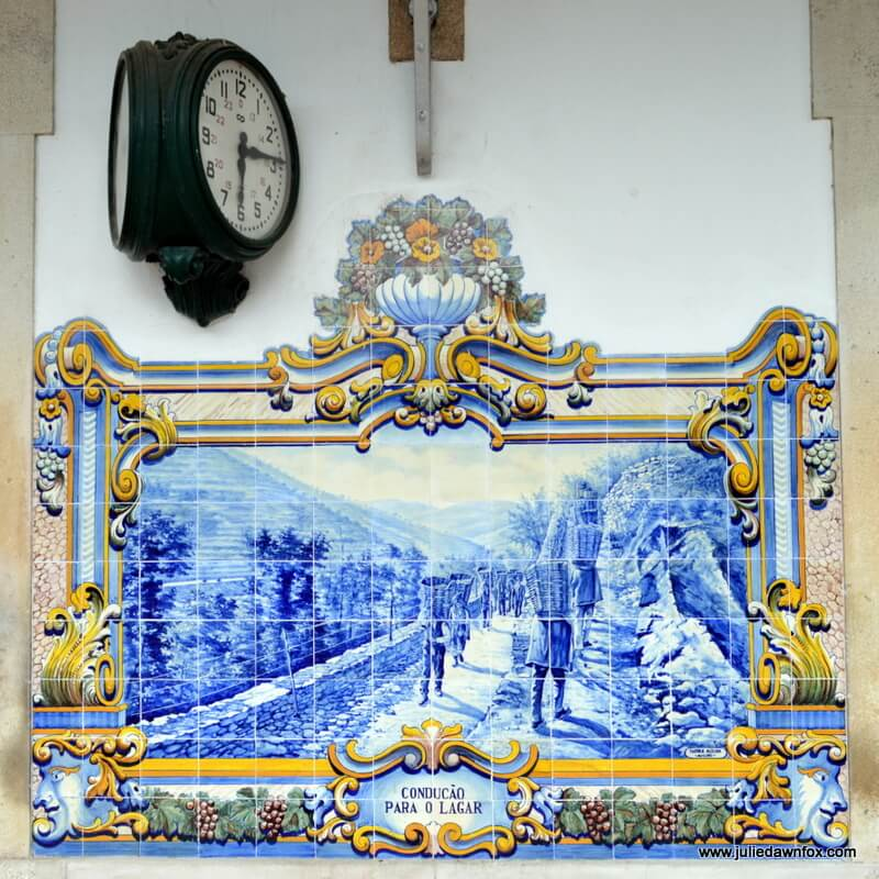 Carrying baskets of grapes, azulejo panel, Pinhão train station