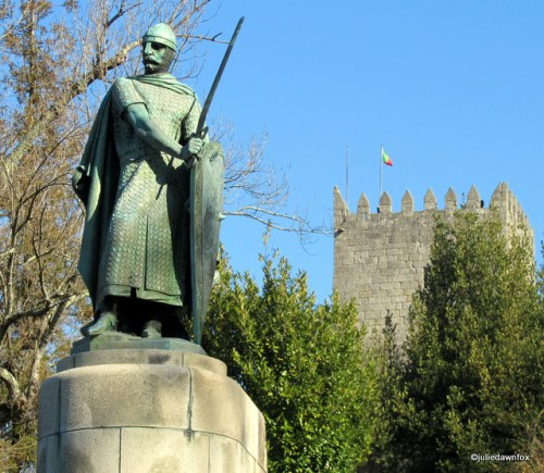 Dom Afonso Henriques, first King of Portugal, in front of the castle in Guimarães