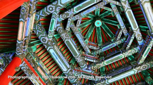 Wooden roof in the summer palace in Beijing, China. Photo by KaKa.