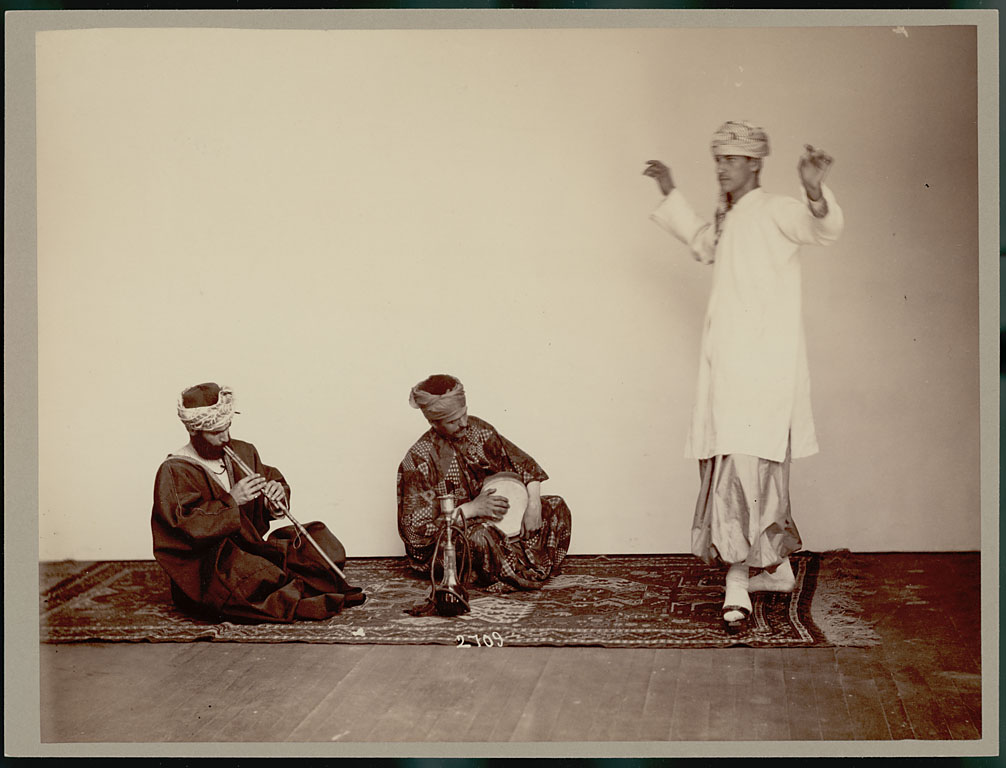 "Three Arbeely brothers performing in ""native dress."" Washington, DC, ca.  1883. National Anthropological Archives of the Smithsonian Institution."