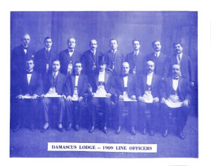 First line officers of Damascus Lodge. Nacle Forzly, Grand Master, is in top hat.