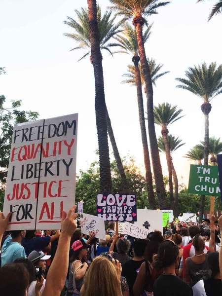 Anti-Trump protesters marched from Kapi'olani Park to the International Trump Hotel in Waikiki chanting and holding signs – Courtesy of Austin Weihmiller