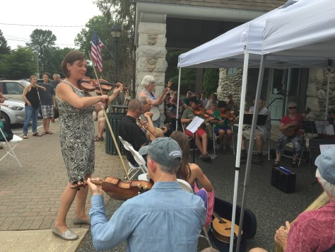 Violin teacher Erika Tludwig leads a string-based ensemble of players of all ages and walks of life in the opening act of the benefit. David regularly plays with this group..