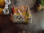 cortina antique souvenir olympic pin