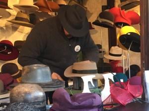 hatmaker, hat fitting, hat stretching, weihnachtsmarkt