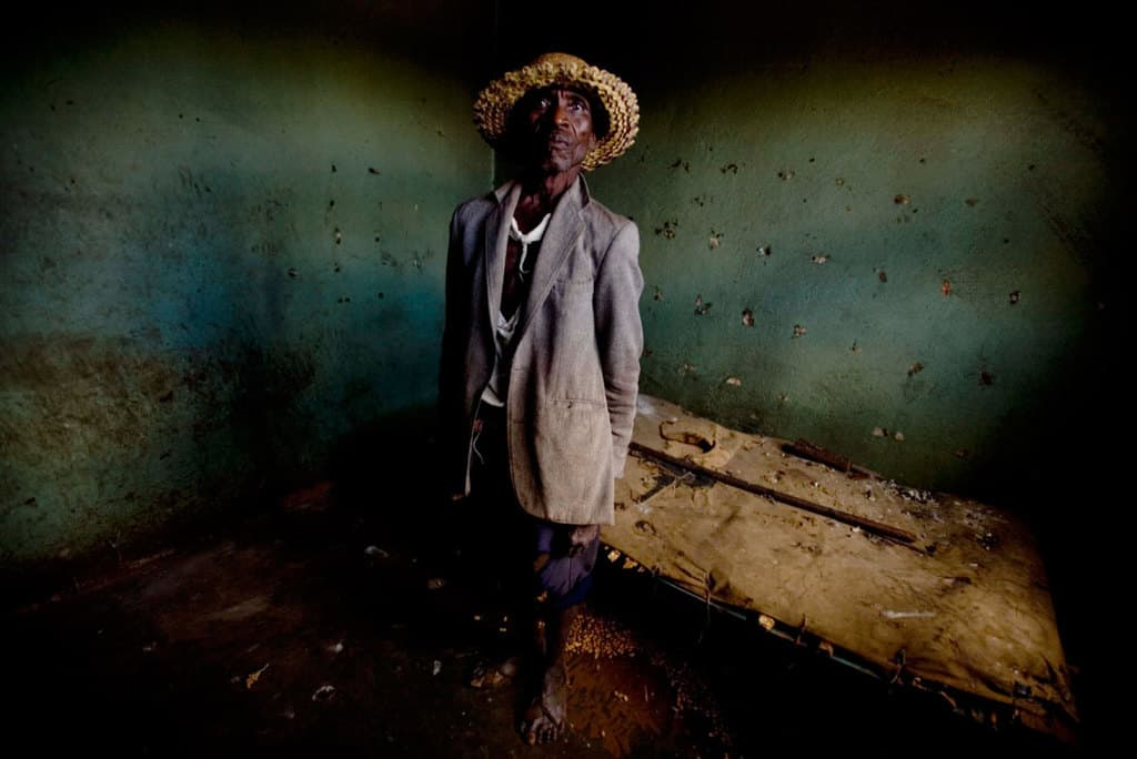 Emmanuel Zinhare, who is struggling to support his family after his savings in Zimbabwean dollars became worthless. Kate Holt.