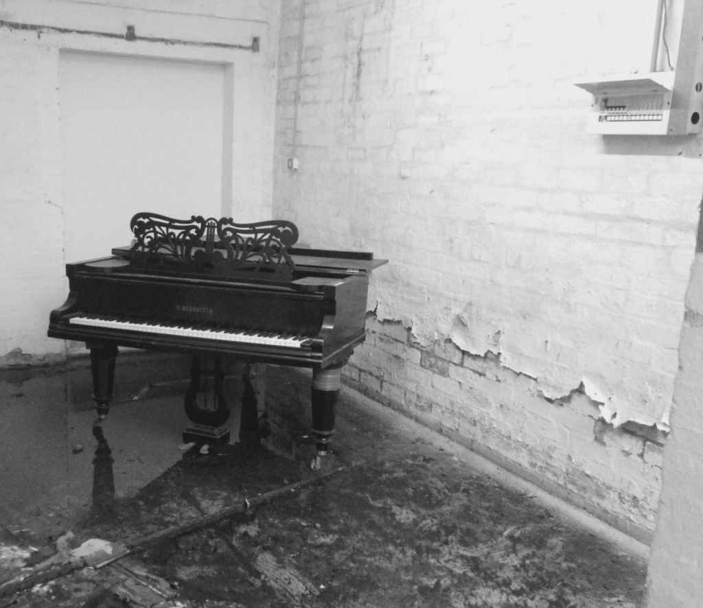 black and white neglected piano