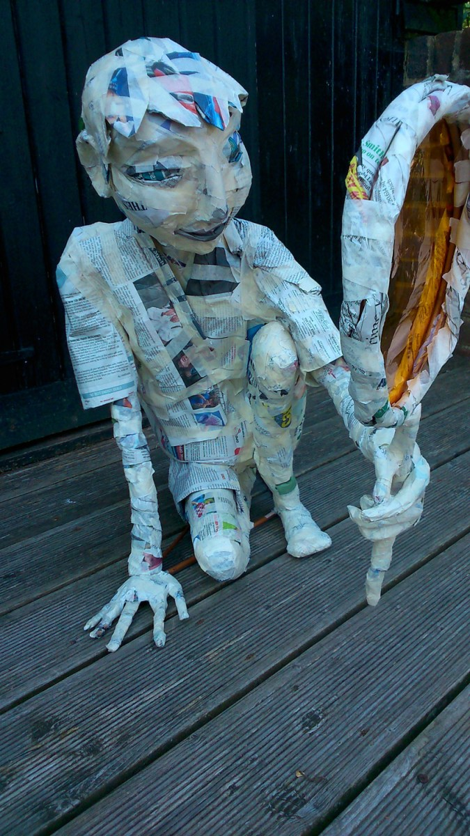 Child, prop, paper sculpture, unfinished sculpture