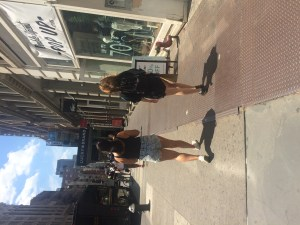 She walks in Soho with her cousin!