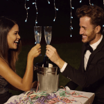 happy-new-year-dinner-celebration-with-a-romantic-elegant-young-couple-toasting-with-flutes-of-champagne-over-a-bottle-in-a-cooler_rd8f6-1h_thumbnail-full01