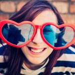 Teenage girl wearing heart sunglasses