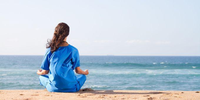 nurse-meditating-on-the-beach