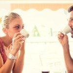 Young couple drink coffee at italian café