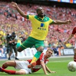 Middlesbrough's Ben Gibson battles for the ball with Norwich City's Cameron Jerome (right) during the Sky Bet Championship Play Off Final at Wembley Stadium, London. PRESS ASSOCIATION Photo. Picture date: Monday May 25, 2015. See PA story SOCCER Championship. Photo credit should read: Nick Potts/PA Wire. RESTRICTIONS: Editorial use only. Maximum 45 images during a match. No video emulation or promotion as 'live'. No use in games, competitions, merchandise, betting or single club/player services. No use with unofficial audio, video, data, fixtures or club/league logos.
