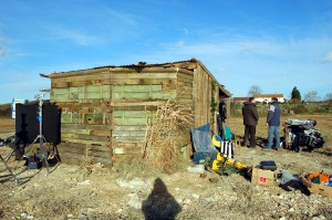 Behind the scenes image of The Hide on the marshes with camera equipment and crew nearby