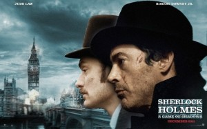 Sherlock Holmes: A Game of Shadows Movie Poster © Warner Bros. L-R Jude Law and Robert Downey Jr infront of a view of London